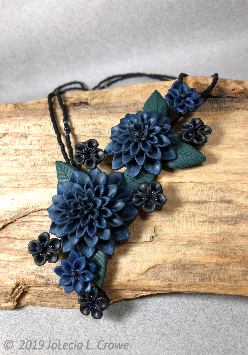Picture of polymer clay necklace with midnight blue mums by JoLecia L. Crowe